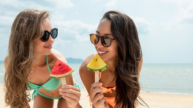 Happy beautiful woman friends at the beach in summer Premium Photo
