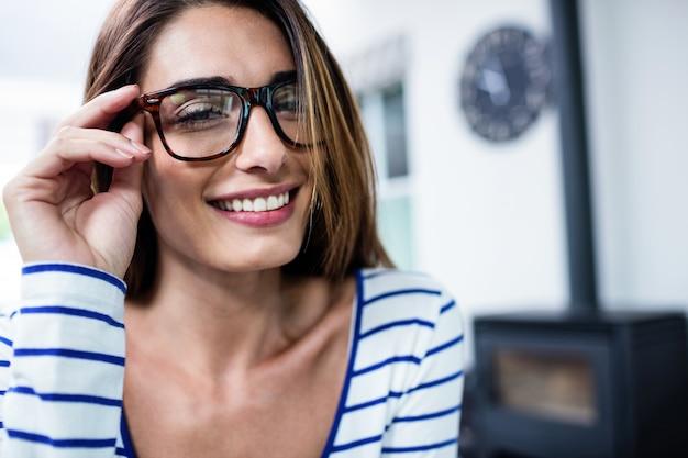 Happy beautiful young woman wearing eyeglasses Premium Photo