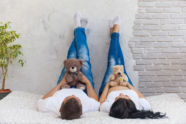 Happy beloved man and pregnant woman at home Premium Photo