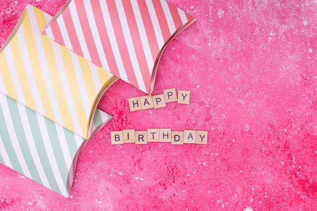 Happy birthday arrangement on pink background Free Photo