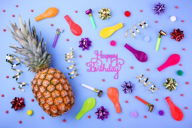 Happy birthday background with pineapple, party confetti, balloons, streamers and decoration Premium Photo