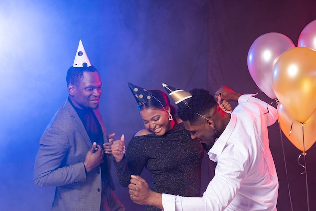 Happy birthday party people dancing and having a good time Premium Photo