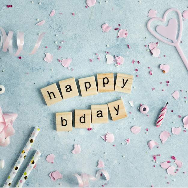 Happy birthday wish in wooden letters with ribbon Free Photo