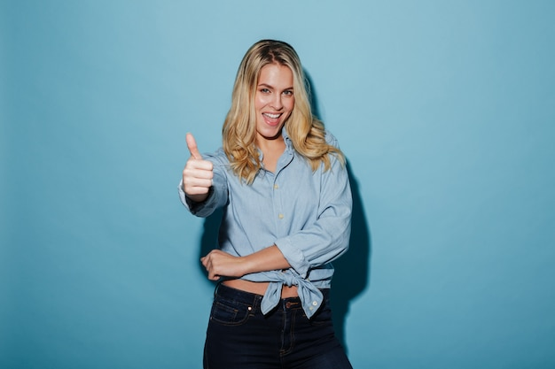 Happy blonde woman in shirt showing thumb up Free Photo