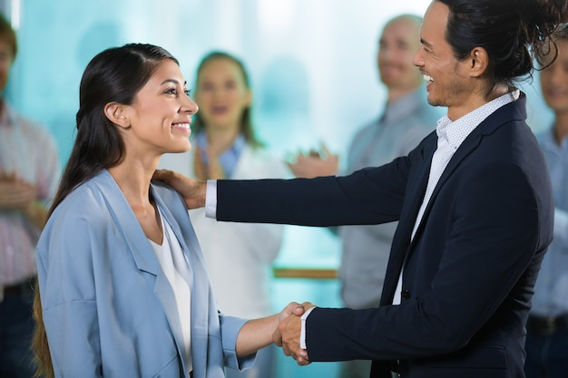 Happy boss greeting new female manager Free Photo