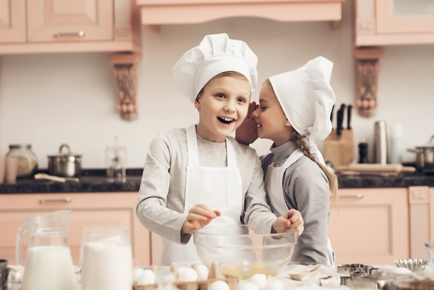 Happy boy and girl cook together at home kitchen Premium Photo