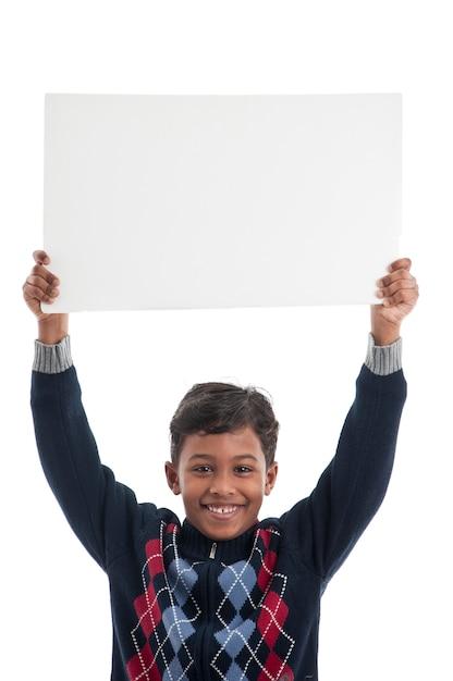 Happy boy holding blank board Premium Photo