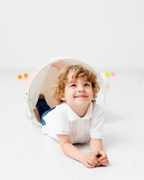 Happy boy posing while playing at home Premium Photo
