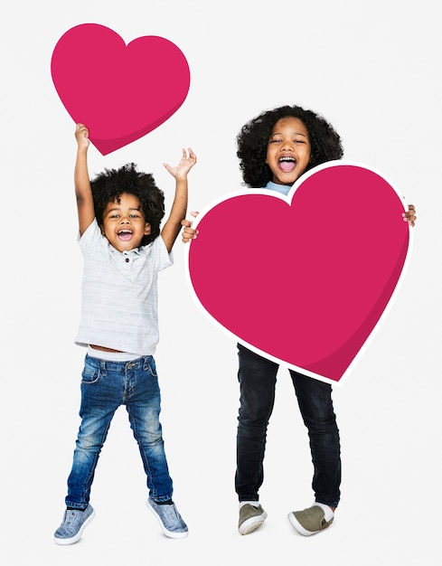 Happy brothers jumping with heart icons Premium Photo