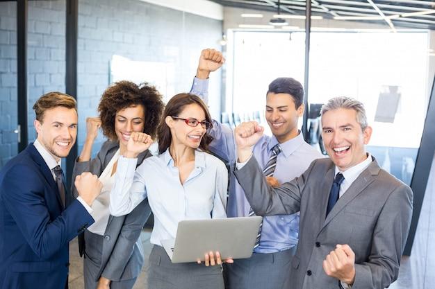 Happy business  team celebrating a success in office Premium Photo