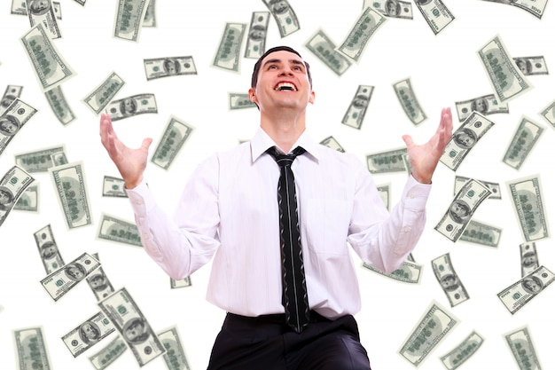 Happy businessman and flying dollar banknotes Free Photo