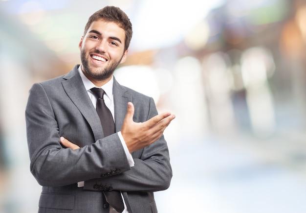 Happy businessman gesturing Photo