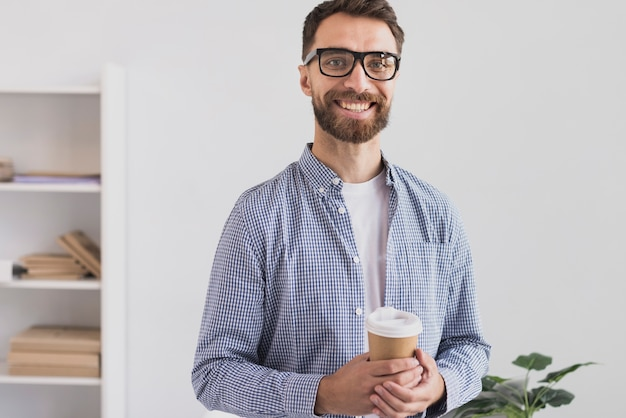 Happy businessman in office Free Photo