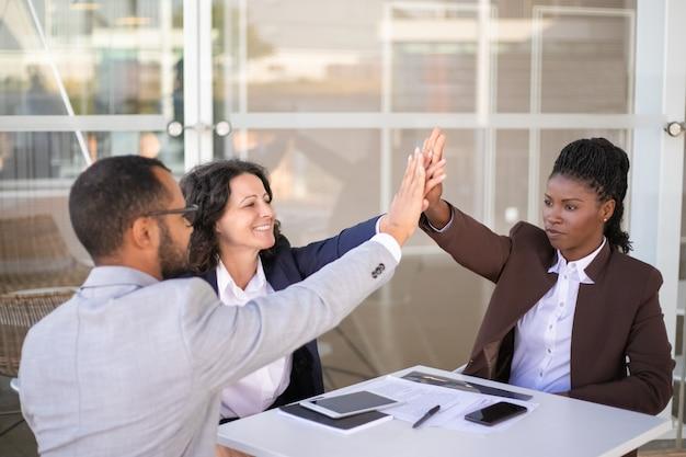 Happy businesspeople celebrating team success Free Photo