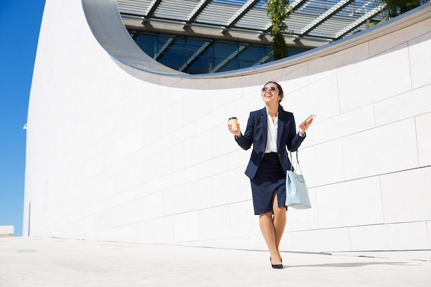 Happy businesswoman excited with good news Free Photo