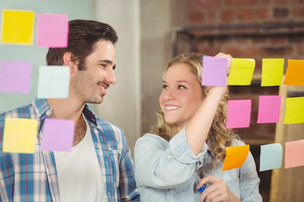 Happy businesswoman looking at colleague in office Premium Photo