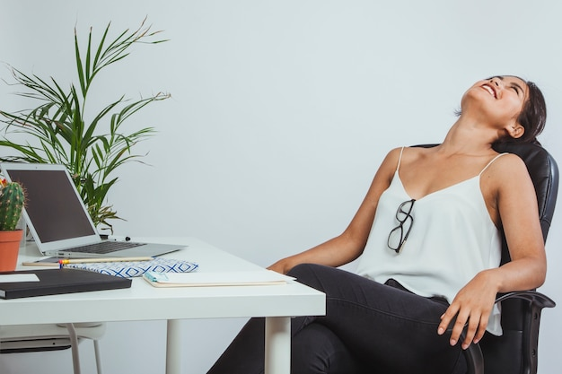 Happy businesswoman resting after a working day Free Photo