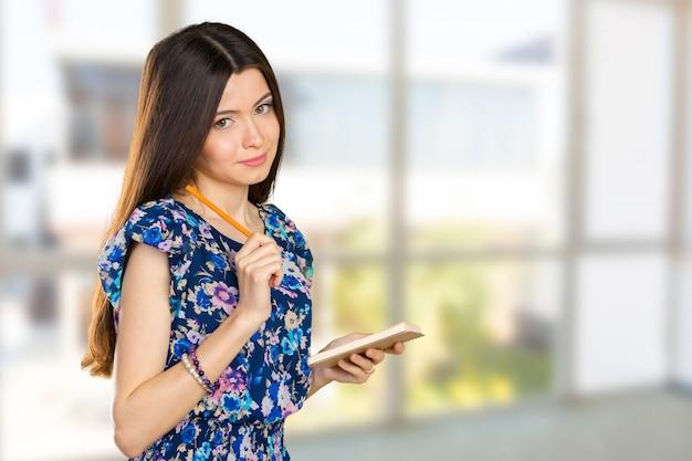 Happy businesswoman taking notes Premium Photo