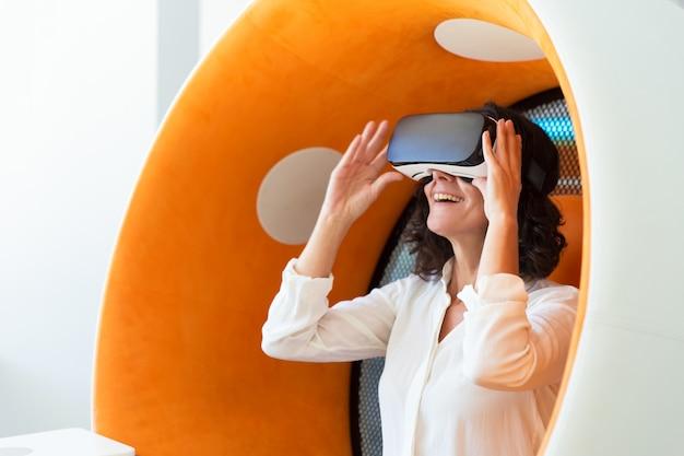 Happy businesswoman watching virtual presentation Free Photo