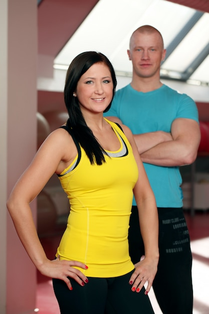 Happy caucasian couple in a gym Free Photo