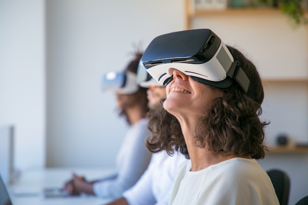 Happy caucasian woman in vr glasses enjoying experience Free Photo