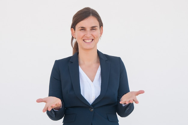 Happy cheerful business leader spreading hands Free Photo