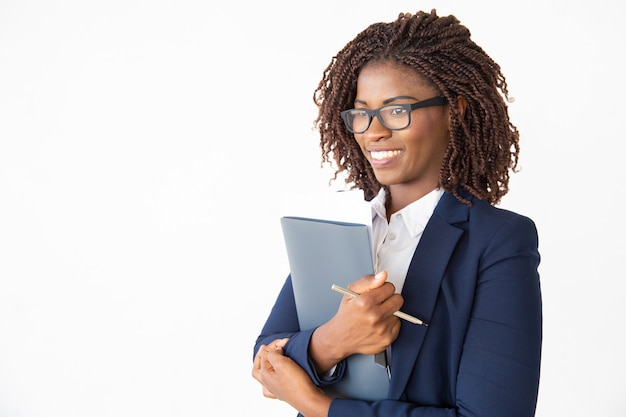 Happy cheerful office assistant in glasses holding documents Free Photo