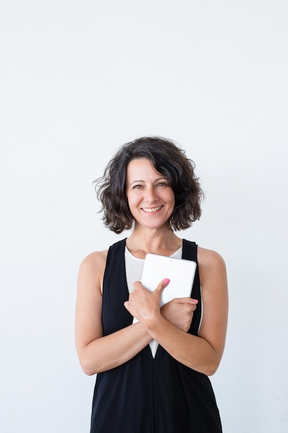 Happy cheerful woman with tablet smiling at camera Free Photo
