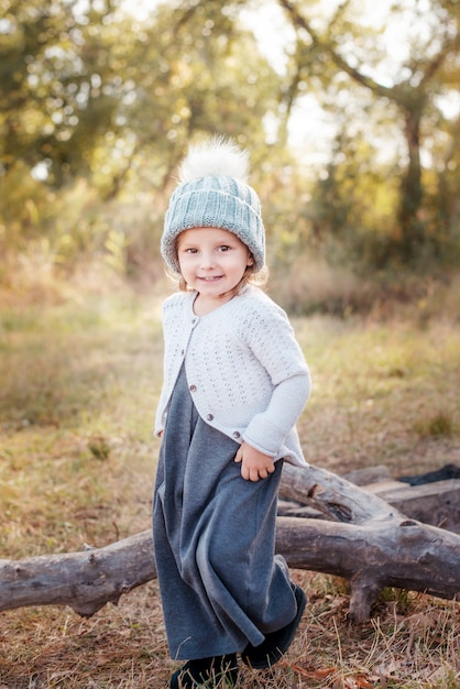 Happy child girl smilling and playing in autumn outdoors Premium Photo