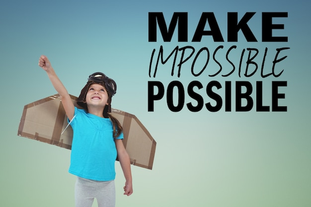 Happy child with cardboard wings and inspirational phrase Free Photo