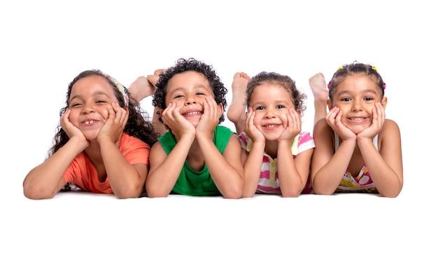 Happy children laying on the floor posing for photo Premium Photo