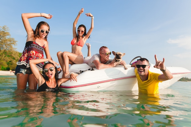 Happy company of friends on summer tropical vacation in thailand traveling on boat in sea, party on beach, people having fun together, men and women positive emotions Free Photo