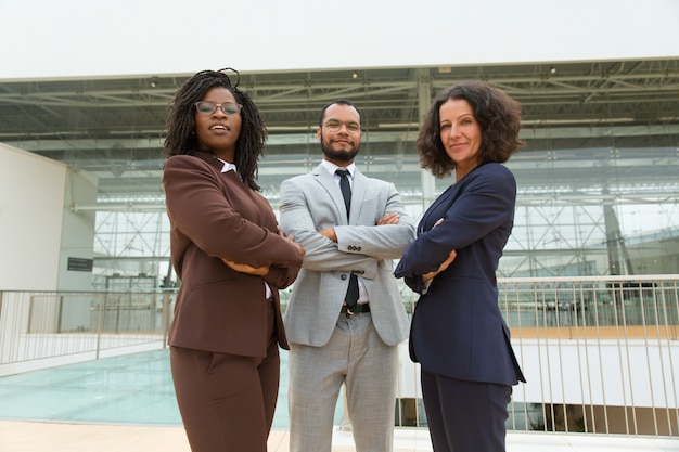 Happy confident business team posing in hallway Free Photo