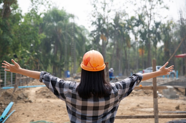Happy construction worker and work. portrait of satisfied bricklayer with copy space. Free Photo