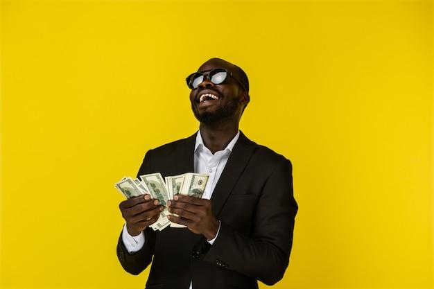 Happy cool man enjoys the money Free Photo