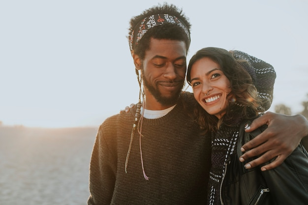 Happy couple at the beach Free Photo