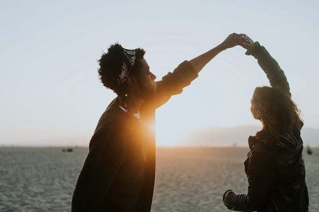 Happy couple dancing at the beach Free Photo