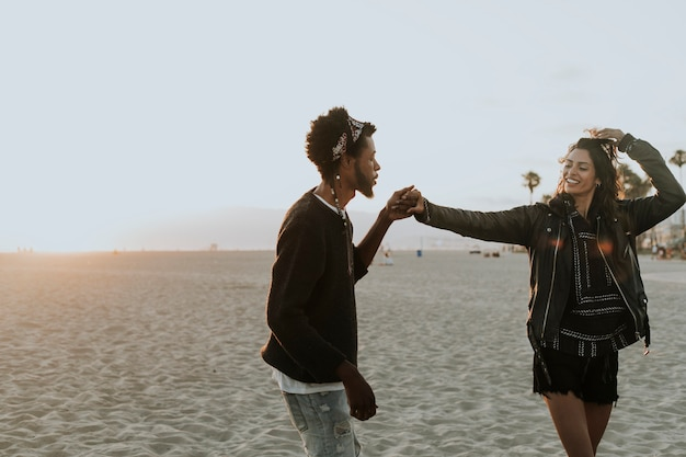 Happy couple dancing at the beach Premium Photo