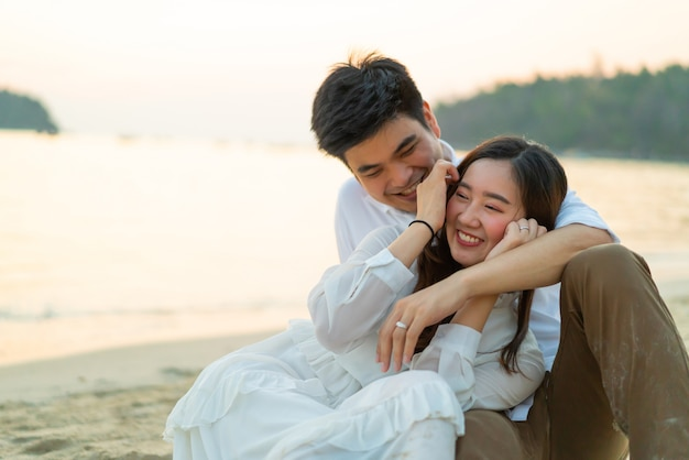 Happy couple going honeymoon travel on tropical sand beach in summer Premium Photo