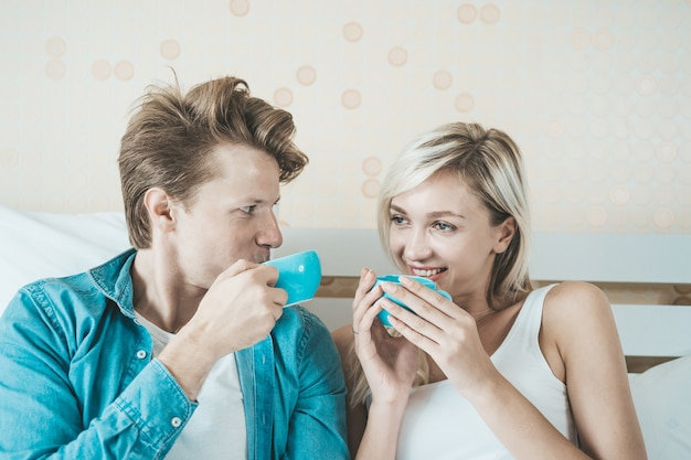 Happy couple hand holding cup and drinking coffee in the morning Free Photo