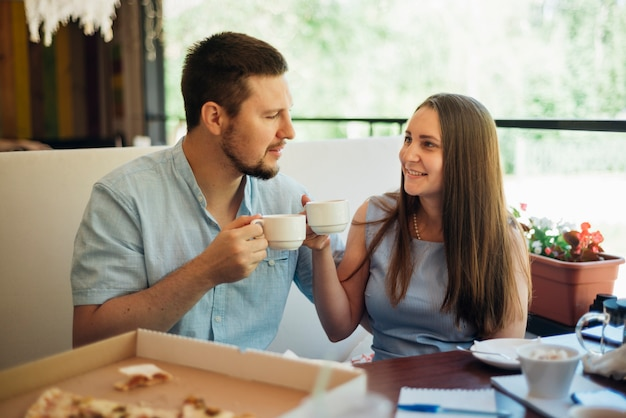 Happy couple having breakfast with coffee Free Photo