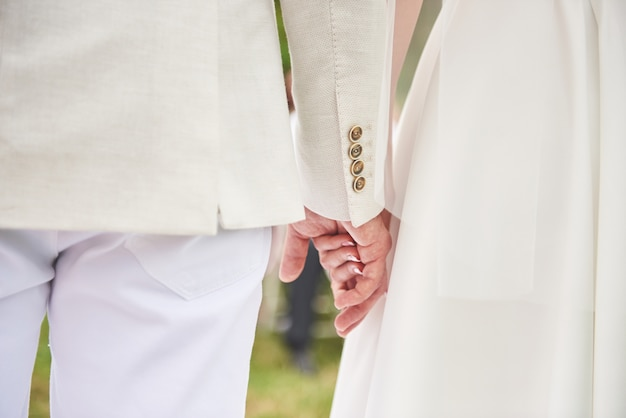 Happy couple holding hands together as forever love. Free Photo