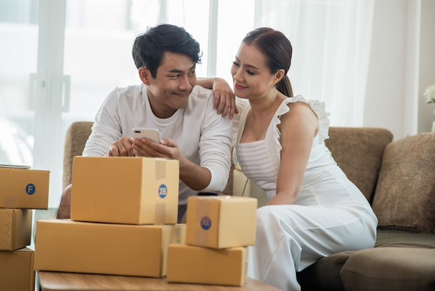 Happy couple at home office with online business, marketing online and freelance job Free Photo