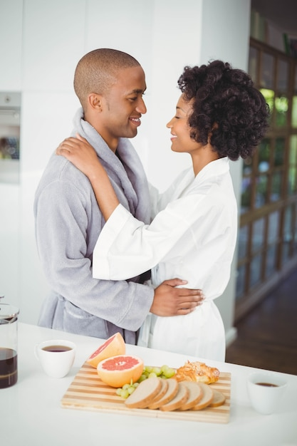 Happy couple hugging in the kitchen at home Premium Photo