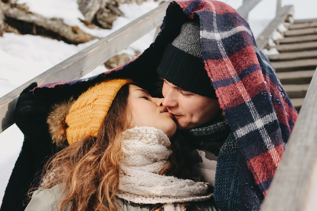 The happy couple in love making selfie at forest park in the cold season. travel adventure love story Premium Photo