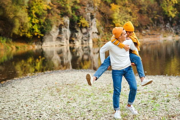 Happy couple in love on a walking in beautiful autumn day Premium Photo