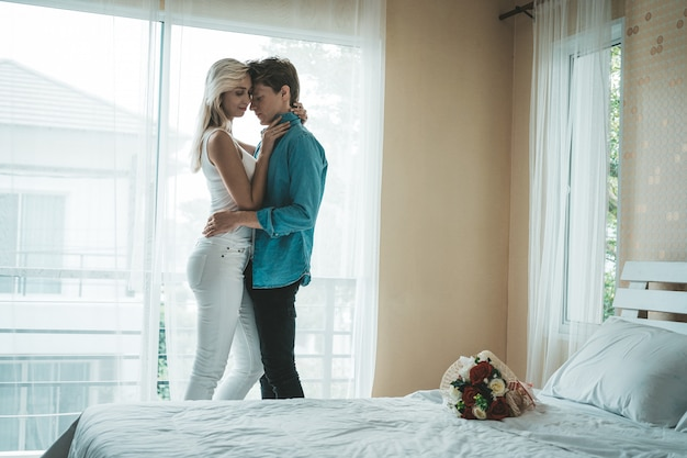Happy couple playing together in the bedroom Free Photo