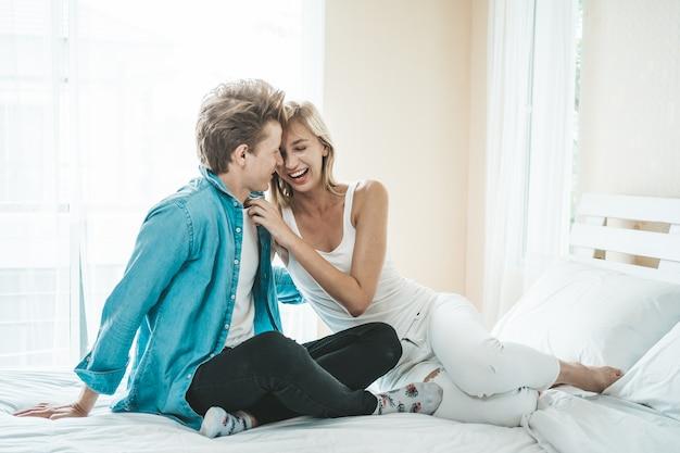 https://image.freepik.com/free-photo/happy-couple-playing-together-bedroom_1150-12033.jpg