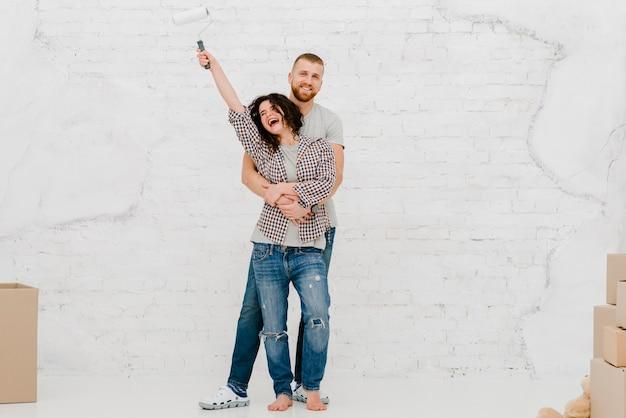 Happy couple posing in new flat Free Photo