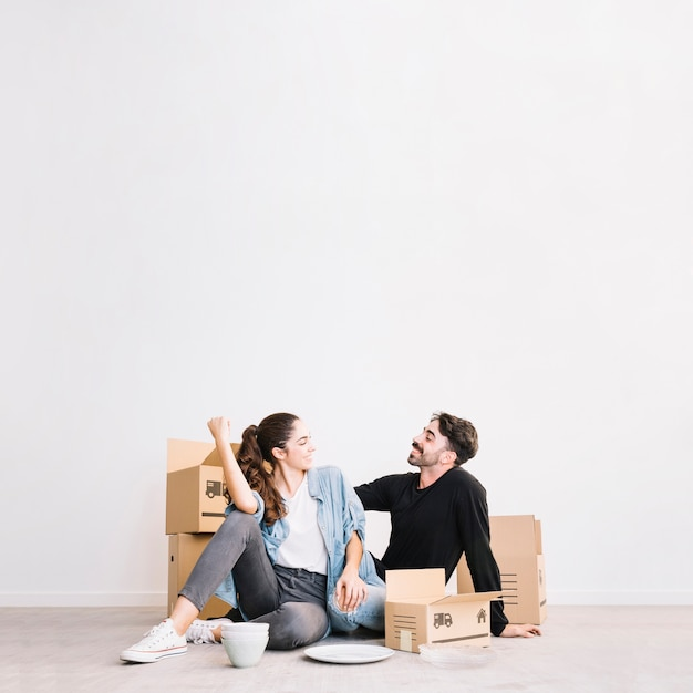 Happy couple sitting in front of moving boxes 23 2147703557